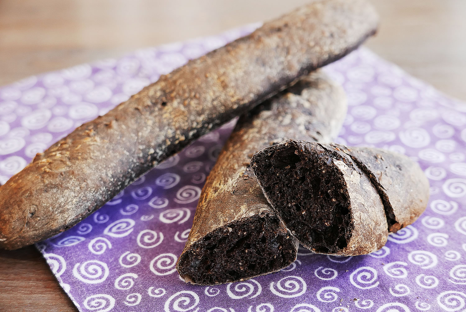 Black baguette made with black cocoa powder